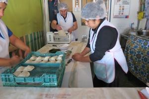 ladies making empanadas