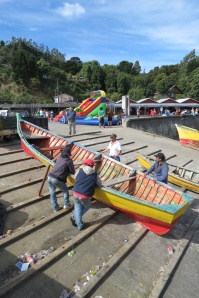 fishermen hauling boats just below fair