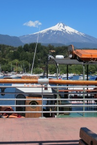 busy little port with volcano